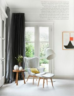 Featherston chair, Caravaggio floor lamp -  love this look