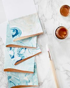 Marbling is a beautiful (and easy! I made these marbled indigo and gold place cards with blue food coloring and a bit of liquid gold gilding, and I absolutely LOVE the way it turned out!