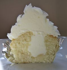 Oh lawd. White Velvet Almond Cupcake- googled Cakeboss's white velevet cake recipe and Paula Deen's Almond buttercream recipe