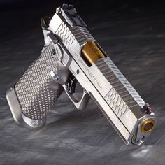 "Full Titanium 5"" .40 S&W Double Stack 2011. Weighs under 30oz. www.sviguns.com - Beretta 92FS Compact Grips http://www.rgrips.com/en/beretta-92-96-compact-grips/81-beretta-92-96-compact-grips.html"