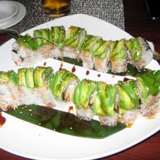 Caterpillar Roll - Sushi Recipe drizzled with eel sauce  topped with black sesame seed or toboki  filling is eel