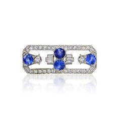 http://www.ross-simons.com/products/768001.html    C. 1930 Vintage 4.30 ct. t.w. Sapphire and 2.70 ct. t.w. Diamond Pin In Platinum