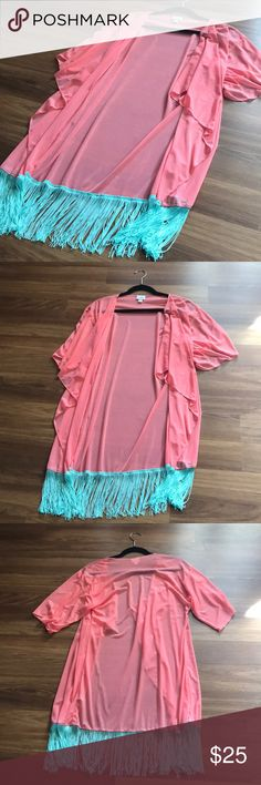 LulaRoe Monroe - S NWOT LulaRoe Monroe Kimono. This Monroe is so pretty! I took the tags off and brought it on vacation to use as a swim coverup but never ended up using it. It's like a melon pink color with aqua fringe. It is sheer with a faint flower design. (I held it up in the picture so you could see.) Wear it over a dress, tank top, or swimsuit. Lots of options! 😊 Size Small LuLaRoe Tops