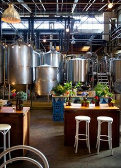 Great warm, simple space where brewery and tasting room meet (note milk crate table!). Nice how it is all integrated. Looks like a wedding or party setup. Tommy Collins - Mountain Goat brewery