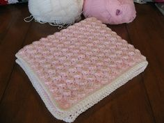 """Bubbles Baby Blanket"" for Fraggle- N size hook, 2 strands of Lion Brand ""Pound of Love"" in Pink & White (girl) (pattern: http://www.crochetpatterncentral.com/patterns/bubbles_baby_blanket.php)"