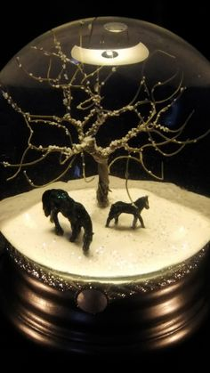 Snow Globe - Mare & foal under winter-bare tree. Still my favourite snow globe to this day. QueenOfSnowGlobes.com