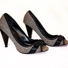 CLEARANCE Heels with Bow Brown and Black Peep Toe heels with Black Accent Bows. Perfect for work. Comfortable shoes. A few marks from wear. Well loved but have lots of life in them! Michael Antonio Shoes Heels