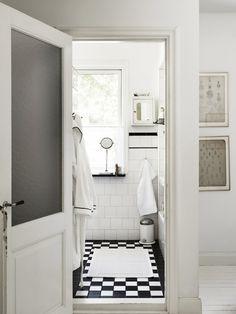 checkerboard floor, white + black tile wainscot