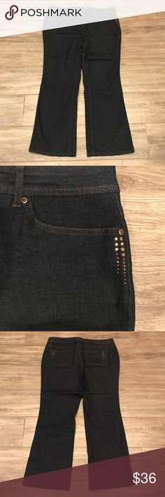 """Susan Graver Embellished Denim 5-Pocket Jeans 20W These NWOT jeans are a five-pocket dark wash boot cut jeans. Embellishments on the front and back make the look fashionable, flattering, and fun. They have belt loops all the way around, front fly with one-button logo closure, back pockets with logo, front and back embellishment detail. The fabric is made of  80% cotton, 19% polyester & 1% spandex blend. Approximate measurements are waist 42"""", hips 47"""", front rise 14.5"""" and inseam 32"""". Susan…"""