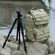 Khaki Green Canvas Outdoor Camera Bag/Laptop Bag Medium Backpack, whistle on CLIP (no tripod included) + Cosmos ® Cable Tie. he Careell Backpack will hold hiking equipment, personal items, and photographic/video gear. Its intricate design provides an optimal solution for photographic equipment storage without compromising space for hiking gear. $73.99