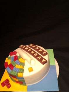 My first cake! Victoria sponge with white chocolate Grenache and fondant icing! For all those Lego lovers!