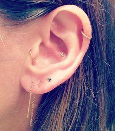http://www.cosmopolitan.co.uk/fashion/style/a35132/cool-ear-piercing-ideas/