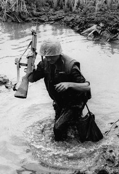 US Marine on Operation Deckhouse Five in Jan 1967 in the Mekong Delta .. note the M14 with double mags taped together