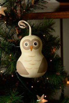 "Our hand-painted Owl Ornament is approximately 2 1/2"" in diameter and 3.5"" tall."