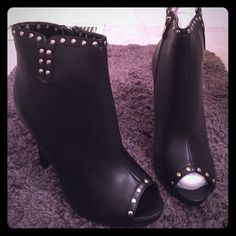 Torrid Black Studded Heeled Booties NWT Size 10 Gorgeous peep toe black ankle booties by Torrid. Accented with studs and a side zipper. Heel is approximately 3 inches. Brand new in box. torrid Shoes Heeled Boots