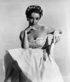 Elizabeth Taylor wearing a wedding gown, 1956.