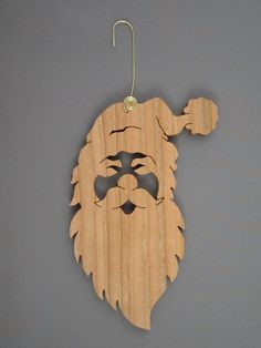 Isnt this the perfect example of a santa. He was scroll sawn out of 1/4 cherry wood and measures 5 1/2 tall and 2 1/2 across. For easy hanging a handmade brass hanger was added. A Danish oil finish was used to bring out the beauty of the cherry wood.