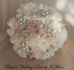 9 CUSTOM FABRIC WEDDING BOUQUET - $325.00 Full Price ________DETAILS _____________ 9 Design = 26-27 in circumference $325.00 6 Design = 23-24 in circumference $225.00 (Perfect for matching bridal party bouquets, also $169.00 without pearl stands) This Bouquet can be made in any
