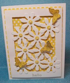 I used the Big Shot to cut out a bunch of Daisies and put them in an open frame. (3 3/4″ x 5″ outside dimensions of frame, with a 1/2″ border) I used a lot of dimensionals so the flower layer would remain lifted above the yellow dotted layer. That layer is 1/8″ larger in length and width than the frame. This was all mounted on a traditional Whisper White card base folded to 5 1/2″ x 4 1/4″