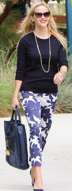 Who made  Reese Witherspoon's floral pants, suede pumps, cat sunglasses, tote handbag, and key chain?