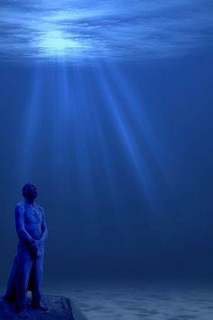 Men on fire light 2 by Cancun Underwater Museum, via Flickr