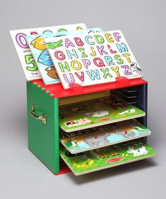 Every piece has a place, and every piece will be in its place when a little one solves this entertaining set of puzzles! Easy-to-grab pegs help small hands grasp as they learn about animals, colors, numbers and the alphabet. When it's time to clean up, each puzzle stores smartly within the deluxe painted storage case. Smart!
