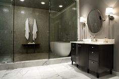 Love the shower and tub in enclosed glass. And LOVE the gray walls! Looking all over for this color.