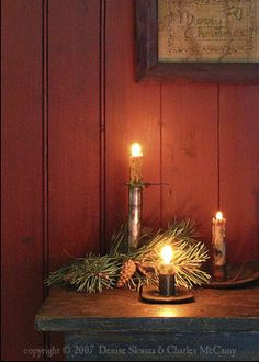 Love all the candles with a little greenery...
