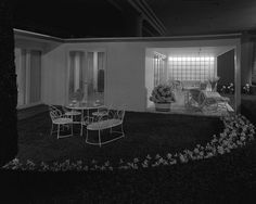 """1937 Another Depression Era prototypical MCM. Another """"Modern House,"""" this time, seen from the outside. Curvy details on the patio set have a slightly more feminine feel, while the window mimics the so-trendy look of glass block tiles."""