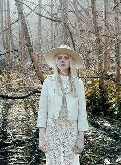 With Hearts In My Eyes Lace Bias Cut Gown, Yestadt Millinery Alabaster Peaks Hat, and The Sway White leather jacket.  Styled by Madley