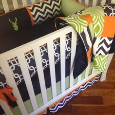 Modern 4pc. Crib bedding set in navy, lime green, and orange includes deer head embroidery on Etsy, $465.00