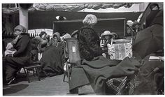 Survivors of the Titanic aboard the Carpathia rested on deck chairs, wrapped against the cold. Via @National Museum of American History, Smithsonian
