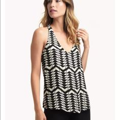 Ella Moss Zaire Tank Top All arrows point to the Zaire Tank Top. High contrast style in black and white. Deep v-neckline. Sleeveless. Shirttail hem. Back cutout detail.  Gorgeous print relaxed and flowy fit. Ella Moss Tops Blouses