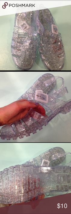 Jelly sandals glitter clear Really cute nwot clear jelly sandals with silver glitter Shoes Sandals