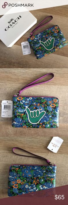 """NWT Coach """"Rose Meadow"""" Corner zip wristlet """"Hang Loose"""" corner zip wristlet from Coach. With a blue floral print leather! So fun! Perfect for summer! 6"""" long and 4"""" wide! Tags attached and care card included! Comes with gift box and tissue paper! Coach Bags Clutches & Wristlets"""