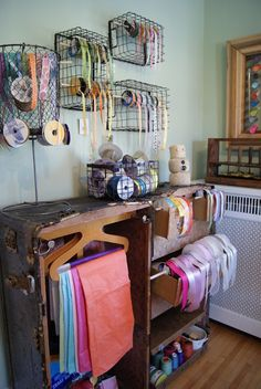 Cool craft room! Love the old trunk as storage; I just happen to have 2 or 3 old trunks we found in the other garage last summer! guess it's time to air them out!