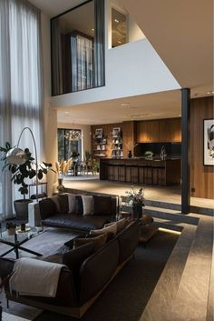 living room and kitchen / large homes black and brown home decor