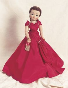 """Cissy in Red Taffeta Ball Gown by Alexander 20"""" (51 cm). Hard plastic socket head,green sleep eyes,real lashes,painted lower lashes,dark eye shadow,feathered brows,closed mouth,auburn hair with curly bangs pulled back from head and into arranged curls at the nape of neck,adult lady body with bendable knees and elbows. Costume: red taffeta ball gown with elaborately draped neckline and sash,decorated with rhinestones,over,red taffeta hooped petticoat tulle ruffle,matching panties,stockings,silver"""
