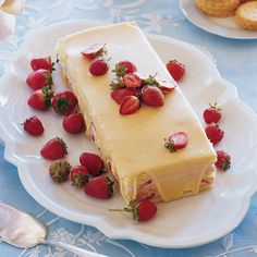 Covered with white-chocolate ganache, this strawberry-mousse cake makes the perfect sweet ending to lunch.