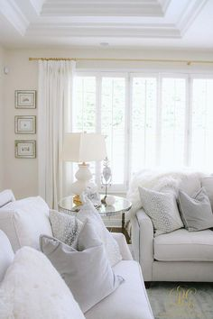 How to Create a Livable + Beautiful Family Room - Randi Garrett Design. Neutral, white living room with feather throw pillows and white gourd lamp. Wrinkle free drapes for the win! Coastal Living Rooms, Living Room White, White Rooms, New Living Room, Small Living Rooms, Living Room Interior, Cottage Living, Coastal Cottage, Small Room Design