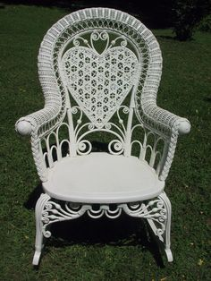 pretty white wicker chair with heart back