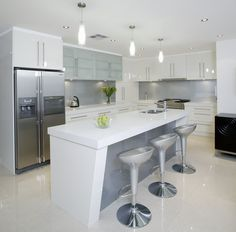 White kitchen with grey glass splash back - Like the combination of colours and stainless steel appliances.