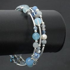 Blue aquamarine, pearl, gemstone & crystal wire wrapped bracelet by Beadstorm Jewellery