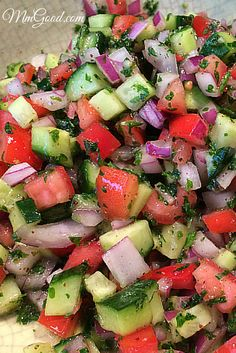 Israeli Salad is the perfect summer side dish. Cucumbers, tomatoes and red onions in a simple dressing makes it perfect for picnics as well. My recipe has a secret/twist to it | MmGood.com