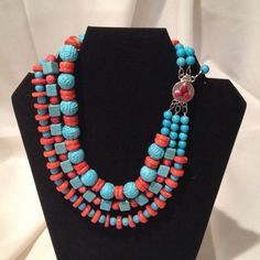 Fashion  jewelry Beautiful statement jewelry. 3 strand necklace, coral & carved turquoise, sterling silver / coral clasp.  #913N Jewelry Necklaces