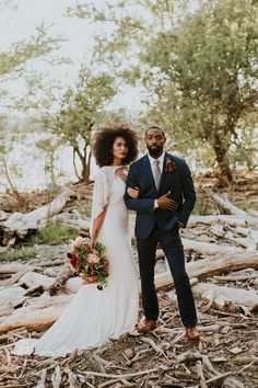 This elopement inspiration at The Falls of the Ohio features a pomegranate and dusty blue color palette and a vow exchange and picnic near the river. wedding couple Pomegranate Inspired Elopement Shoot at The Falls of the Ohio