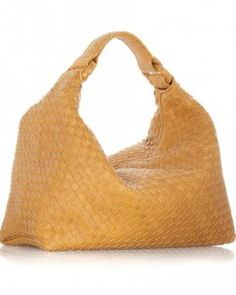 """Hobo Bag: a large crescent-shaped shoulder bag or any large bag that hangs from your shoulder and has a main compartment closure (unlike the """"tote"""" which is normally open top).  Haleymatul Jannah FD1A1"""
