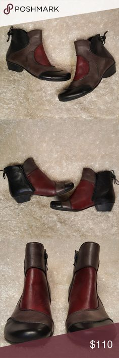 Remonte Milla 80 Multicolor Leather Ankle Boots Rieker Remonte Dorndorf Milla 80 Multicolor Leather Ankle Boots Excellent condition; Like new! Black, red, & brown. Leather Upper; Textile interior; PU outsole. Comfy cushioned footbed, full side zip. Heel height: 1 1/2 in Euro Size 41 / US Size 9.5 *Offers welcome!* Rieker Shoes Ankle Boots & Booties