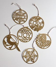 I am adding my finishing touched to my holiday tree this week and one of my handmade ornaments are these elegant paper cut pieces that are made from glitter paper. These are not only great for tree decorations but make a beautiful addition to any holiday package. Cut them from glitter paper, red, green or white and they are a great handcrafted touch! #diyholiday #handmade #holidaydecorations