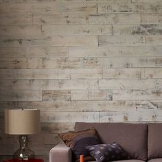 This is SO cool -  Adhesive Wood Paneling.  I would LOVE to do this on an accent wall